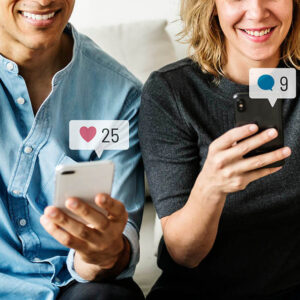 happy people using social media on their smartphone